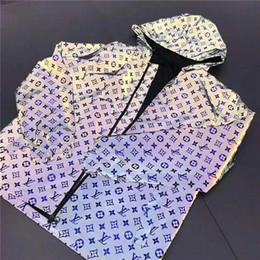Модные женские пальто онлайн-Мужская дизайнерская куртка с капюшоном пальто молния роскошные светоотражающие свободного покроя плащ с капюшоном мужчины женщины марка ветер пальто мода марка размер M до 2XL