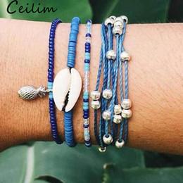 bracelets bohème multicouches Promotion 5pcs / set bohême tressé shell perles bracelet ensemble pour les femmes multicouche cire corde bracelet avec chaîne perle charme d'ananas pour les femmes d'été