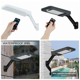 Lampade solari per pareti online-60 LED Sensore di movimento PIR a luce solare IP65 Lampada da giardino dimmerabile da parete per esterni Lampada solare Telecomando ZZA269