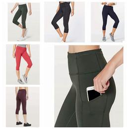 Wholesale Mujeres Trajes de Yoga Damas Deportes Capri Leggings Verano Pantalones Cortos Ejercicio Fitness Wear Girls Marca Ejecución Leggings ZZA238