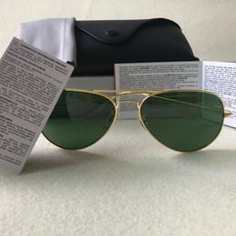 Cajas espejadas online-Clásica de calidad superior Piloto gafas de sol de metal Primera marca para las lentes para mujer para hombre de plata espejo de cristal con protección UV400 casos y Box