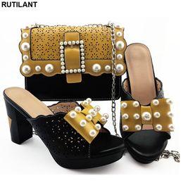 0d2ee6b221485 Eşleşen Ayakkabı ve Çanta Seti Topuklu Nijeryalı Ayakkabı ve Eşleşen Çanta  Seti Rhinestone ile Dekore Lüks Kadın Tasarımcılar