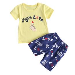 Niños Bebé Niña Niño Cartton Carta Imprimir Tops Camiseta Rayas Pantalones Trajes Conjunto de ropa Trajes Ropa para niños Niños 5.25 desde fabricantes
