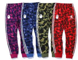Skate streetwear online-Otoño Streetwear Nueva Moda Hip Hop Pantalones Hit Color Rayas Carta Mujeres Hombres Pantalones Elásticos Pantalones de skate