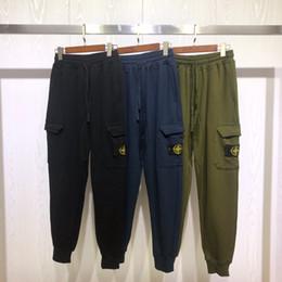 Calças campismo ao ar livre on-line-19FW Novo design de marca de luxo bússola preto azul ganância faixa calças homens mulheres moda esporte basculador calças de moletom ao ar livre