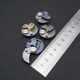 2019 brinquedos de titânio Qualidade superior Mini Pingente de liga de Titânio TC4 Coin toy Folding faca Chaveiro Pingente de Moeda Pequeno Diâmetro EDC Ferramenta Multifuncional Ao Ar Livre