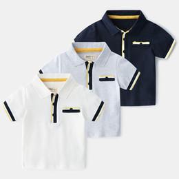 Pantalones cortos de niños británicos online-2019 Nueva solapa clásica de verano Camiseta para niños Enfant Camiseta de polo a rayas de algodón de estilo británico para niños Camisetas de manga corta para bebés