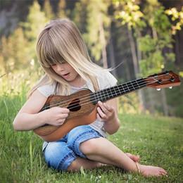 Mini Anfänger Klassische Sichere einfache Ukulele Gitarre 4 Saiten Pädagogisches Musikinstrument für Kinder Weihnachtsgeschenk von Fabrikanten