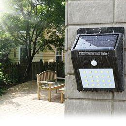 светодиодные лампы для солнечных ламп Скидка Солнечная энергия LED Солнечный свет Уличные настенные светодиодные солнечные лампы с датчиком движения PIR Ночной безопасности Лампа Уличный Двор Путь Сад лампы Лампа ZZA265
