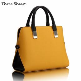 Bolso de diseñador negro amarillo online-Venta al por mayor- Bolsos de mano para mujer de color amarillo Diseñadores PU Famosos bolsos de diseñador Bolso de cuero azul negro de lujo Mujeres Sac elegante