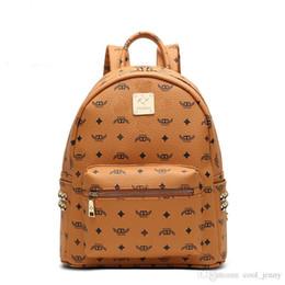 Mochila coreana para laptop online-Diseñador de moda de los hombres de la escuela coreana estudiante mochilas venta caliente remache Punk mujeres mochila mochila mochila bolsa de gran capacidad portátil