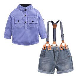 Camisa azul de cuello mandarín online-Boy Traje de correa Ropa de diseño para niños Camisa con tiras azules Vaquero Un solo pecho Manga larga Pantalones de dos piezas Traje 28