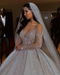 tüll geschichtetes modernes hochzeitskleid Rabatt Luxuriöse Sparkly 2019 Afrikanischer Brautkleider Sheer Ausschnitt mit langen Ärmeln Brautkleider wulstiger Sequins Satin Brautkleider