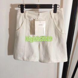 2019 calças de vestido branco feminino Mulheres meninas branco denim shorts calças jeans sexy solto shorts do vintage saia mini-calça high-end personalizado de moda vestido de pista de luxo desconto calças de vestido branco feminino