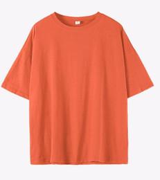 2019 nueva versión coreana suelta color sólido blusa de mujer cuello redondo manga corta camiseta de algodón ropa de mujer desde fabricantes