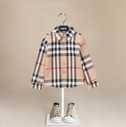 Camicie a maniche lunghe in puro cotone per bambini di mezza età e stile inglese Primavera e autunno Camicie con bottoni a pressione da vestiti occidentali del bambino all'ingrosso fornitori