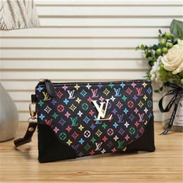 Portafoglio a mano delle signore piccole online-Portafoglio colorato a buon mercato per le donne Nuova moda Lady Luxury Leather Canvas Hand Bags Zipper Clutch Bag 22 * 13