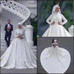 9fdec2e80d4e Vintage arabo musulmano abiti da sposa in pizzo appliques collo alto maniche  lunghe sweep treno abiti da sposa abiti da sposa BC0393 sconti abito da  sposa ...