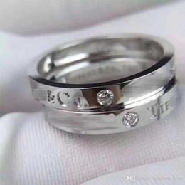 Три алмаза из титана стали роскошные дизайнерские ювелирные изделия женские кольца обручальные обручальные кольца комплекты мужские ювелирные изделия кольца из розового золота, серебра, золота от Поставщики обручальные кольца 18-каратного бриллианта
