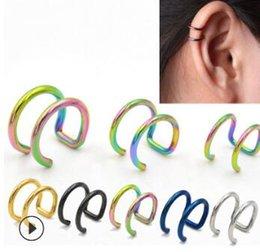 Europa y Estados Unidos Transfronterizo de acero inoxidable Multi Ear Clip Dos vueltas larga varilla Ear Stud Body Arts Tatuajes Body Art HA203 desde fabricantes