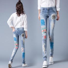 Jeans scarni grandi piedi online-Personalità stampato pantaloni femminili dell'edizione del han di esposizione dei jeans e piedi scarna sottile lavato i pantaloni a matita grandi cantieri NZK colore chiaro