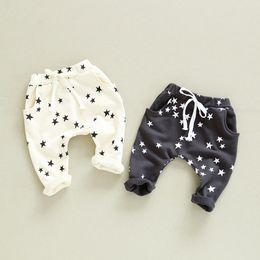 12 meses ropa de marcas para niños Rebajas 2017 PRIMAVERA otoño niñas niños pantalones niños estrellas impresos pantalones casuales bebé beige gris oscuro moda pantalón niños ropa 1-6T