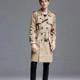 Cinturones de gabardina para hombre online-Escudo largo Inglaterra Estilo Moda Hombre Caqui foso ceñida Mediados más el tamaño 6XL doble de pecho negocios rompevientos Trench