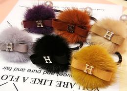 Lujo creativo piel de piel real Signage H bola perla decoración anillo de pelo decoración del partido sombreros suministros desde fabricantes