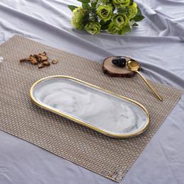 keramik kuchen tablett Rabatt Nordischen Stil vergoldete ovale Platte kreative Keramikplatte Marmoriert westlichen Dish Set Dish Snack Platte Kuchen Desktop Ablage S Größe