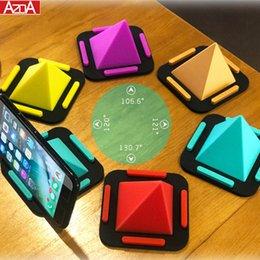porta case mobili Sconti Supporto per telefono cellulare in silicone a forma di piramide con supporto per auto per desktop