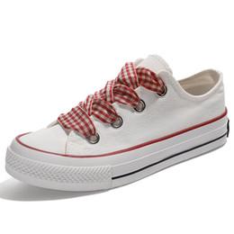 Argentina Nuevo Salvaje Color Sólido Zapatos de Lona Femenino Clásico Pequeño Blanco Zapatos Mujer Marea Seda Vendaje jooyoo Suministro