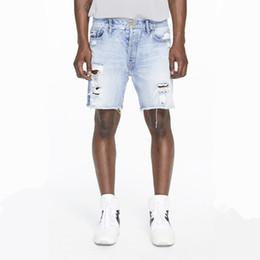 Mens Ripped Short Jeans Destroyed Hole Distressed Denim Jeans Male Biker  Men Clothes Streetwear Fear of God Pants 730dd8145