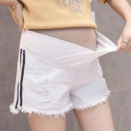 2019 roupas de moda para grávidas Calças de Maternidade Calças de Maternidade Verão Nova Moda Casual Denim Buraco Grávidas Mulheres Calças de Estômago Elevador Roupas Grávidas desconto roupas de moda para grávidas