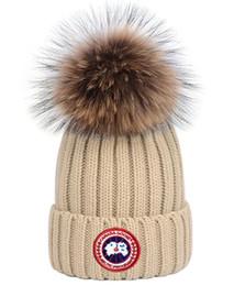 2019 chapéu de esqui de moda Top qualidade Moda Unissex Designers Canadá CA chapéu gorros ganso casual homens gorro de lã tricotada esportes gorros de esqui pom mulheres crânio cap capotas desconto chapéu de esqui de moda
