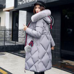 2019 Escudo de Big invierno de la piel abajo cubren las señoras del algodón de Down Parka Parka espesado Mujeres Mujeres de costura larga delgada de invierno desde fabricantes