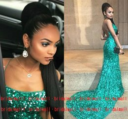 Vestido sin espalda verde esmeralda online-Emerald Green Sequined Mermaid Vestidos de baile para mujer Sexy Spaghetti Formal Vestidos de desfile Vestido de fiesta largo y sin espalda Vestido de noche árabe con celebridades