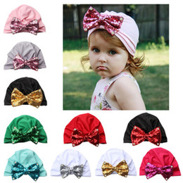 9d9af21caf42a 2019 New Headwear Cap For Newborn Baby Boy Girl Knotted Paillette Pearl Hat  Warm Bow Beanie Shiny Sequin Child Headwear Cap