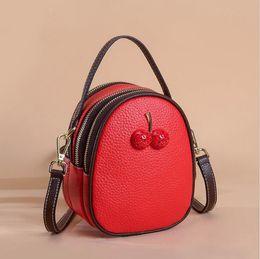 Cuffie delle signore online-2019 Crossbody Cherry per le donne di lusso in pelle Borse Borse a mano Designer Famous Brands Cuffie Hole Tote Shoulder Messenger Bag