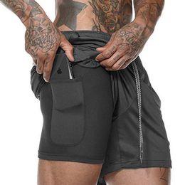 Мужские спортивные шорты онлайн-Double Mesh Design мужские шорты Большой размер Бег Спортивные повседневные брюки Quick Dry Дышащий Фитнес сплошной цвет Пять штанов