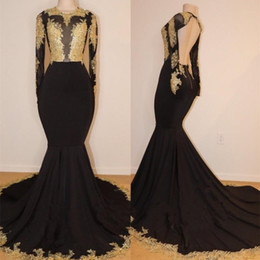 hot sexy see through dresses Coupons - 2019 Hot African Black and Gold Mermaid Prom Dresses High Neck Gold Lace Appliques See Through Open Back Long Sleeves Evening Gowns