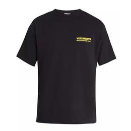 vintage t shirt hip hop Desconto 18ss vetements amarelo logotipo impresso tee vintage cor sólida mangas curtas homens mulheres verão casual hip hop street skate t-shirt HFYMTX167