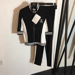 2019 style de célébrités 2019 Printemps Noir Lettre Imprimer Milan Piste 2 Pièces Ensembles 1/2 Manches Tops Et Pantalons Celebrity Style Vestidos 042804 style de célébrités pas cher