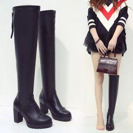005643a0fb8 Muslo alto de cuero ante gamuza acolchada con colinas gruesas talón  plataforma moda zapato de bota negra plana marca de diseñador femenino
