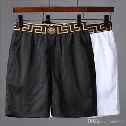 2019 nouveau style pantalon de piste en tissu imperméable Summer Beach Pants Short de surf pour homme Short de surf pour homme Short de bain Shorts de sport ? partir de fabricateur
