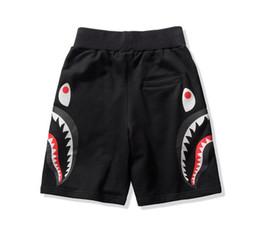 2019 cravate étiquettes en gros Beacch Shorts Shark Hommes Coton Camo Shorts causales Hommes Casual Camouflage Planche à roulettes courtes Pantalons en vrac Streetwear