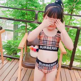 Maillots de bain enfant en Ligne-2019 nouvelles filles d'été maillot de bain à rayures élastiques bien ajustées filles divisées Maillots de bain deux pièces, enfants rayures bikini en gros