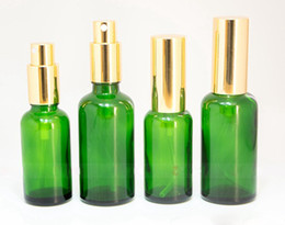 Pulverizador verde online-Gold Silver Black Pump Sprayer 30ml 50ml Green Spray Bottles Glass Cosmetic Perfume Container en venta