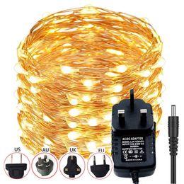 Corda luz led ao ar livre 12v on-line-Impermeável ao ar livre Natal de Luzes 10m 100LED cobre LED Fio Cordas Luz Branco Quente Guirlandas Luz com adaptador de energia