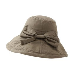 68542e23b87ba3 Free shipping High Quality Casual Sun Caps Women Girls Summer anti-UV  cotton Linen Bow wide brim Beach Hats Visor Floppy Chapeau
