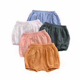 Ropa de bebé online-Bebé recién nacido Pan Pantalones Niños Niña Niño Pantalones cortos Niños Braguitas Algodón sólido Lino Cintura elástica 6